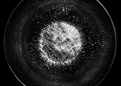 Detail of the water surface in a Tibetan bowl while playing.