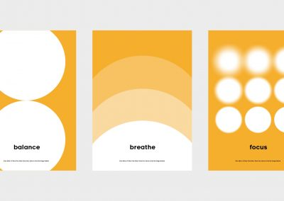 Three posters in series, sharing the same warm yellow, black and white palette and circular graphic elements but representing three separate pieces of advice. From left; 'balance' is represented by a circle balanced atop a second circle of equal size, 'breathe' is represented by circles of gradually decreasing saturation expanding out from the bottom of the poster, and 'focus' is represented by a series of circles arranged in a 3x3 grid that gradually become less blurry.