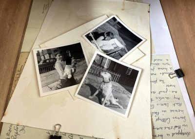 Three black and white photographs of a young boy holding a baby, a dog, and one of a boy next to a baby in a pram lay scattered across coffee stained paper and photocopied images of old handwritten letters. There are also two loose bulldog clips lying on top of the letters. The letters in this piece were deliberately chose to be photocopied as a representation of another kind of memory – perhaps a more second-hand memory, passed down from generation to generation.